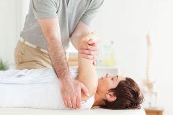 Chiropractic patient receiving a shoulder adjustment.